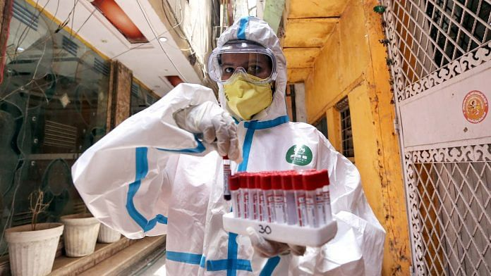 A health worker with Covid-19 samples (representational image) | Photo: ANI