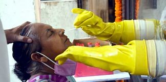 A woman is tested for Covid-19 in Patna, Bihar, Wednesday   Photo: ANI
