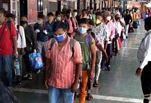 Returning migrants line up at the Dadar Railway Station in Mumbai | Photo: Vasant Prabhu | ThePrint