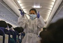 A flight attendant in PPE gear gives safety instructions | Photo: Praveen Jain | ThePrint