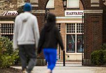 File photo of pedestrians walk through Harvard Yard on the closed Harvard University campus in Cambridge, Massachusetts on 20 April