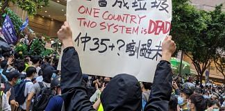 A protester holds up a placard during the protests in Hong Kong against China's imposition of the new national security law. | Poebe Kong/ Twitter