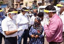 Kiran Dighavkar (in pink shirt) during one of his field visits | By special arrangement