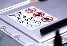 A recycling symbol and handling instructions sit on a lithium-ion automotive battery pack