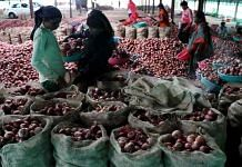 Workers at a godown in Manmad, Nashik, pack onions in sacks for export to Bangladesh | Vasant Prabhu | ThePrint