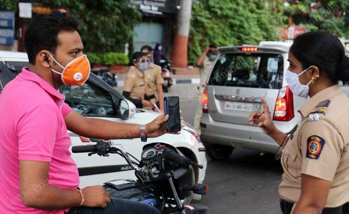 A Pune policewoman manages traffic amid lockdown restrictions in Pune | Representational image | Vasant Prabhu | ThePrint