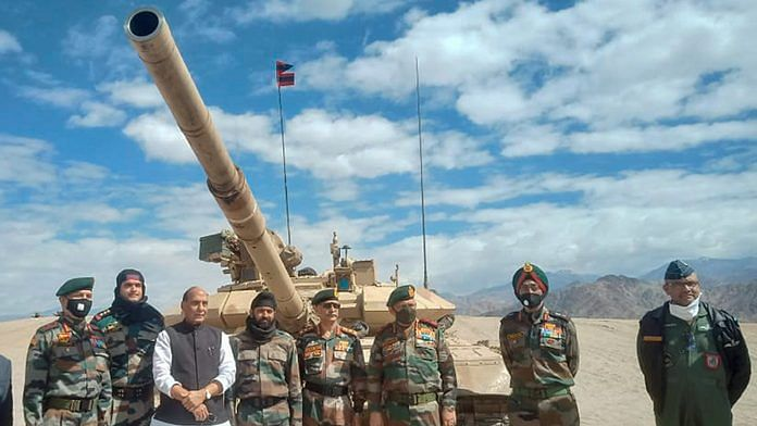 Defence Minister Rajnath Singh poses with officers at a forward base in Ladakh, 17 July | PTI