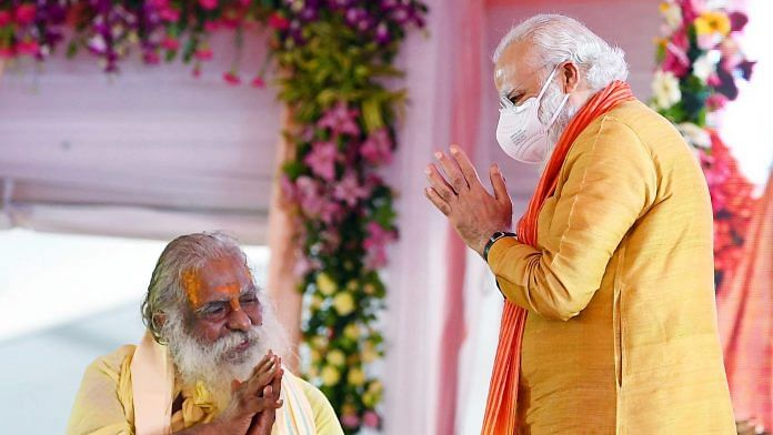 Prime Minister Narendra Modi greets President of Ram Mandir Trust Nitya Gopal Das at the foundation stone laying ceremony of 'Ram Temple, in Ayodhya on 5 August | ANI