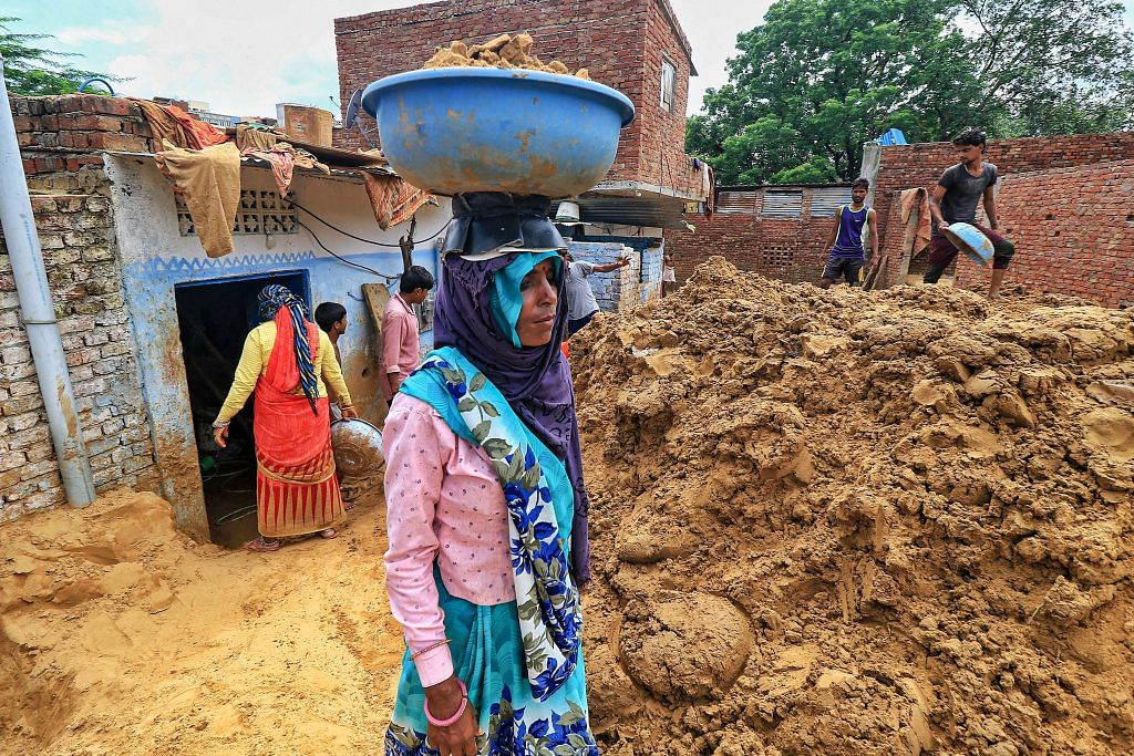 Workers clear landslide debris after heavy rainfall, at Lal Dungri area in Jaipur, 21 Aug | PTI