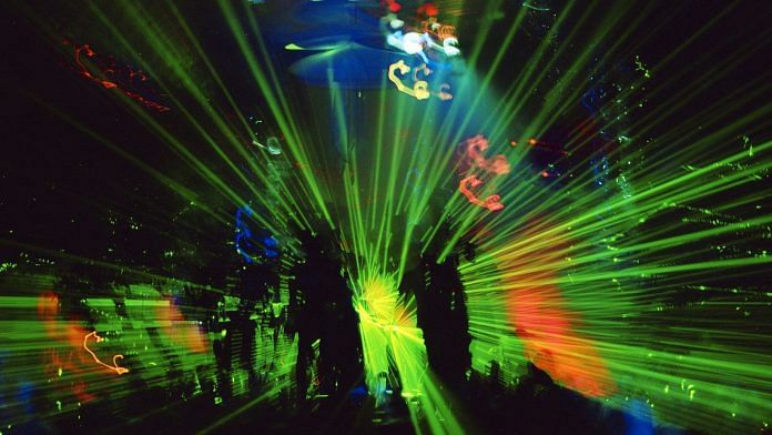 A laser light show at Amnesia, a nightclub in Ibiza | Photographer: Leelu | Bloomberg via Getty Images
