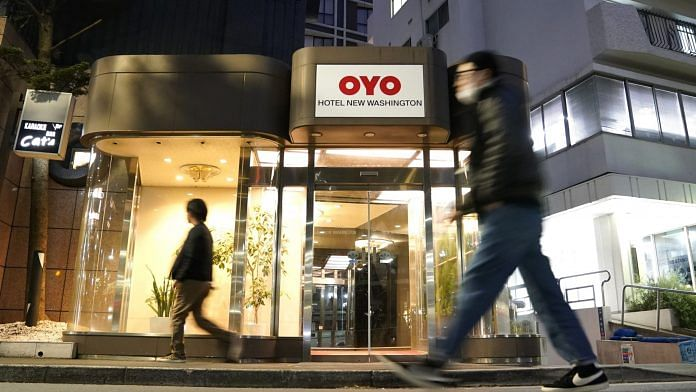 Pedestrians walk past an Oyo hotel, operated by Oyo Hotels Japan G.K., in Tokyo, Japan | Bloomberg