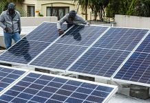 Workers install solar panels onto the roof of a residential property in Johannesburg   Waldo Swiegers   Bloomberg