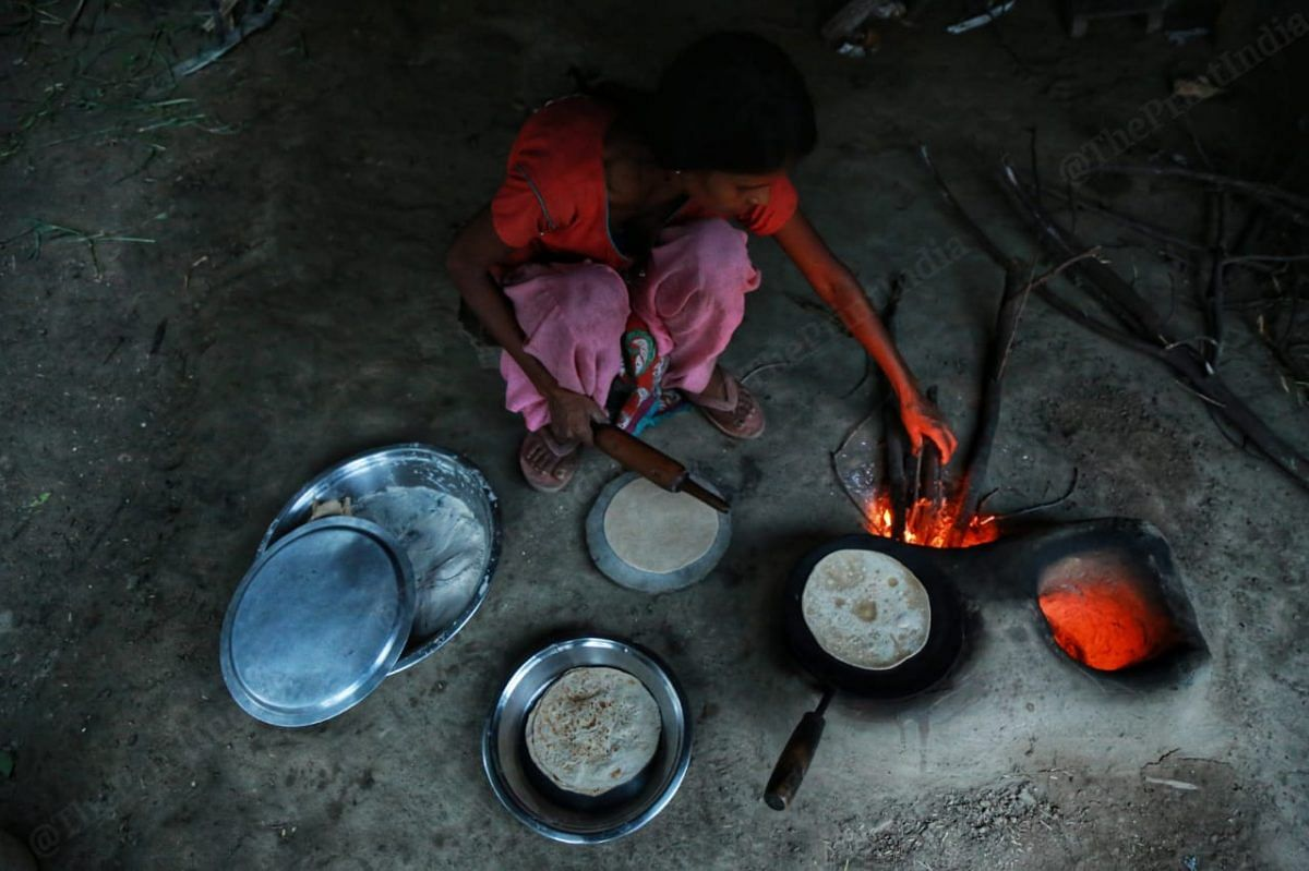 They still like to use the old fashion ovens to cook in order to save | Photo: Manisha Mondal | ThePrint