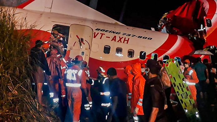 Rescue operation underway after an Air India Express flight with passengers on board en route from Dubai skidded off the runway while landing, at Karippur in Kozhikode | PTI