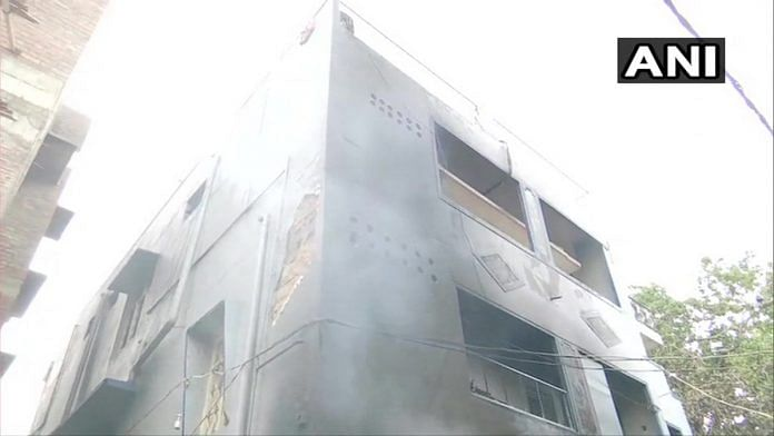 A building torched by the mob in Bengaluru Tuesday night | Photo: @ANI | Twitter