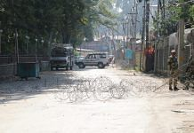 Security forces cordon off the road leading to the office of the PDP in Srinagar | By special arrangement