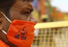 An ascetic wears a mask imprinted with 'Jai Shri Ram' in Ayodhya on the day of the Ram Mandir bhoomi pujan | Photo: Suraj Singh Bisht | ThePrint