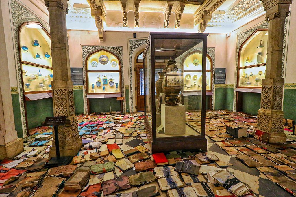 Documents of records kept for drying on a floor after rain water entered the historic Albert Hall museum, in Jaipur, 18 Aug | PTI