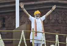 Prime Minister Narendra Modi waving to the crowd | Photo: Arun Sharma | PTI File Photo