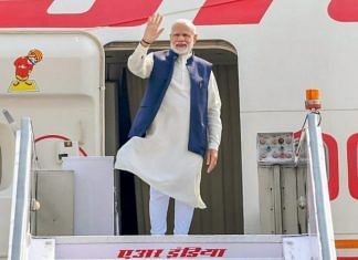 Prime Minister Narendra Modi waves as he boards Air India One for Maldives in November 2018| PTI File Photo