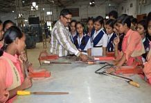 A guest faculty member teaches school girls and students of the fitter trade at Government ITI, Berhampur, Odisha | By special arrangement