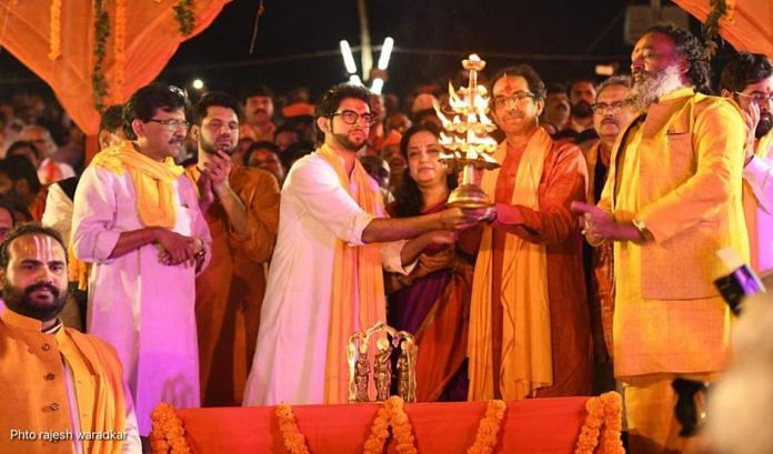Maharashtra CM Uddhav Thackeray, son Aaditya, and Shiv Sena MP Sanjay Raut (far left) offer aarti by the Saryu river in Ayodhya in this December 2018 file photo | Twitter | @AUThackeray