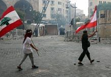 Protesters wave Lebanese national flags during a demonstration close to parliament in Beirut, Lebanon, on Saturday, Aug. 8, 2020 | Bloomberg file