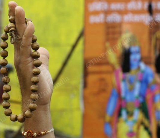 Representational image | A sadhu holds a Rudraksh, a string of beads considered auspicious among Hindus, in Ayodhya | Photo: Suraj Singh Bisht | ThePrint