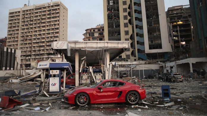 A vehicle sits at a damaged gas station following the explosion at the Port of Beirut in Beirut, Lebanon, on 4 August | Photo: Hasan Shaaban | Bloomberg