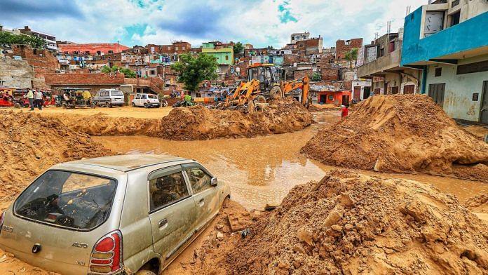 File photo | A vehicle lies buried in landslide debris following heavy rainfall, in Jaipur | PTI