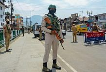 A CRPF jawan stands guard along a street on the first day of the two-day curfew in Srinagar, Tuesday, 4 August, 2020. | PTI