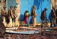 Delhi Police escort a woman and a child to a safe place during the Delhi riots that broke out in February 2020 | Suraj Singh Bisht | ThePrint
