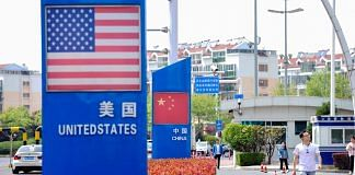 Signs with the US flag and Chinese flag are seen at the Qingdao free trade port area in Qingdao in China on 8 May 2019