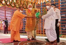 Prime Minister Narendra Modi along with Uttar Pradesh Chief Minister Yogi Adityanath waters Parijaat sapling ahead of the inception of Bhoomi Pujan for the construction of Ram Temple. | PTI