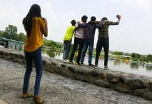 Young people take pictures at Sukhna Lake in Chandigarh, which has now reopened for weekends | Praveen Jain | ThePrint