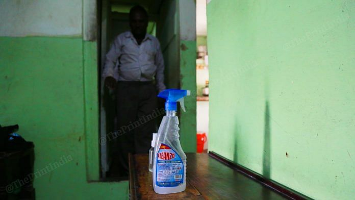A bottle of sanitiser kept outside a room at one of the brothels of GB Road | Manisha Mondal | ThePrint