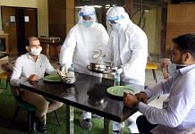 Staff in PPE suits at a restaurant in Bihar | Representational image | ANI