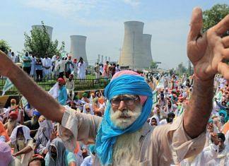 A Bhartiya Kisan Union member protests against three ordinances passed by the Centre, in Sri Muktsar Sahib | PTI