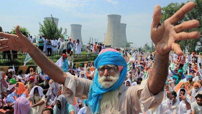 A Bhartiya Kisan Union member protests against three ordinances passed by the Centre, in Sri Muktsar Sahib | PTI