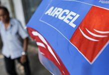 A banner for Aircel Ltd. is displayed outside a mobile phone store in Mumbai on 24 October, 2016. | Photographer: Dhiraj Singh | Bloomberg