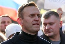 Alexey Navalny, Russian opposition leader, walks with demonstrators during a rally in Moscow, Russia in 2019. | Bloomberg