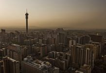 The Hillbrow Tower, operated by Telkom SA SOC Ltd., left, stands on the city skyline at dusk in Johannesburg, South Africa (Representational image)   Photographer: Guillem Sartorio/Bloomberg