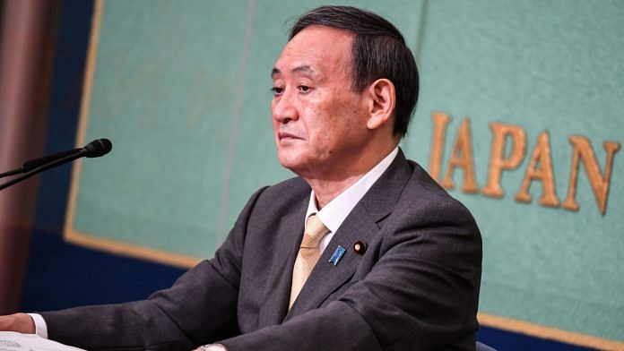 Yoshihide Suga, Japan's chief cabinet secretary, attends a debate ahead of the LDP presidential election at Japan Press Club on Saturday.   Photographer: Charly Triballeau   AFP via Bloomberg