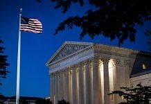 An American flag flies outside the U.S. Supreme Court in Washington, D.C. | Bloomberg