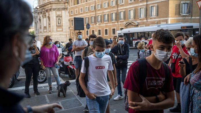Students wearing face masks and keeping their social distance arrive at Newton scientific high during classes after pandemic related closure in Rome, Italy | Photo by Antonio Masiello | Getty Images via Bloomberg