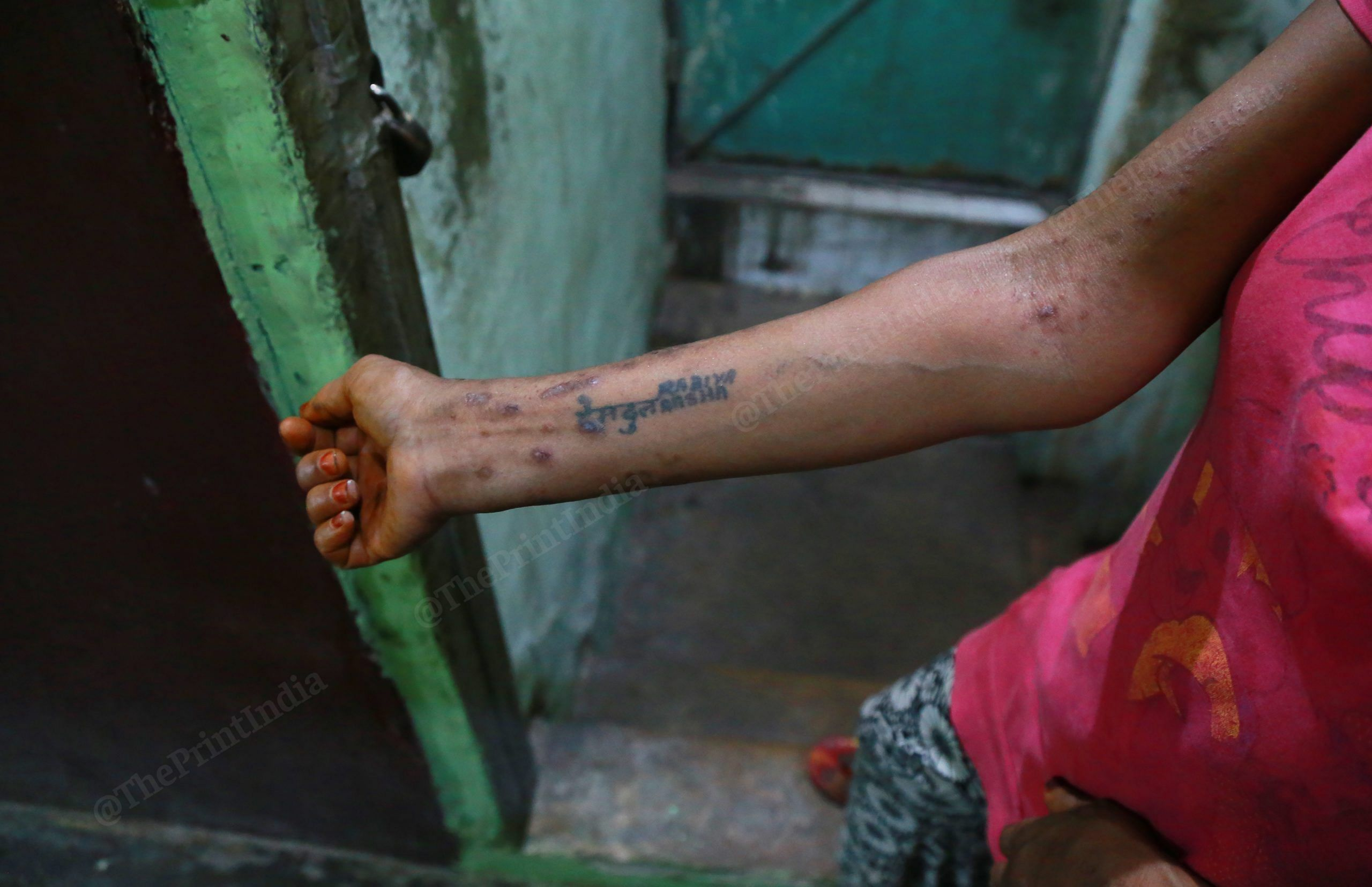 A sex worker shows the names of her family members, tattooed on her forearm | Manisha Mondal | ThePrint
