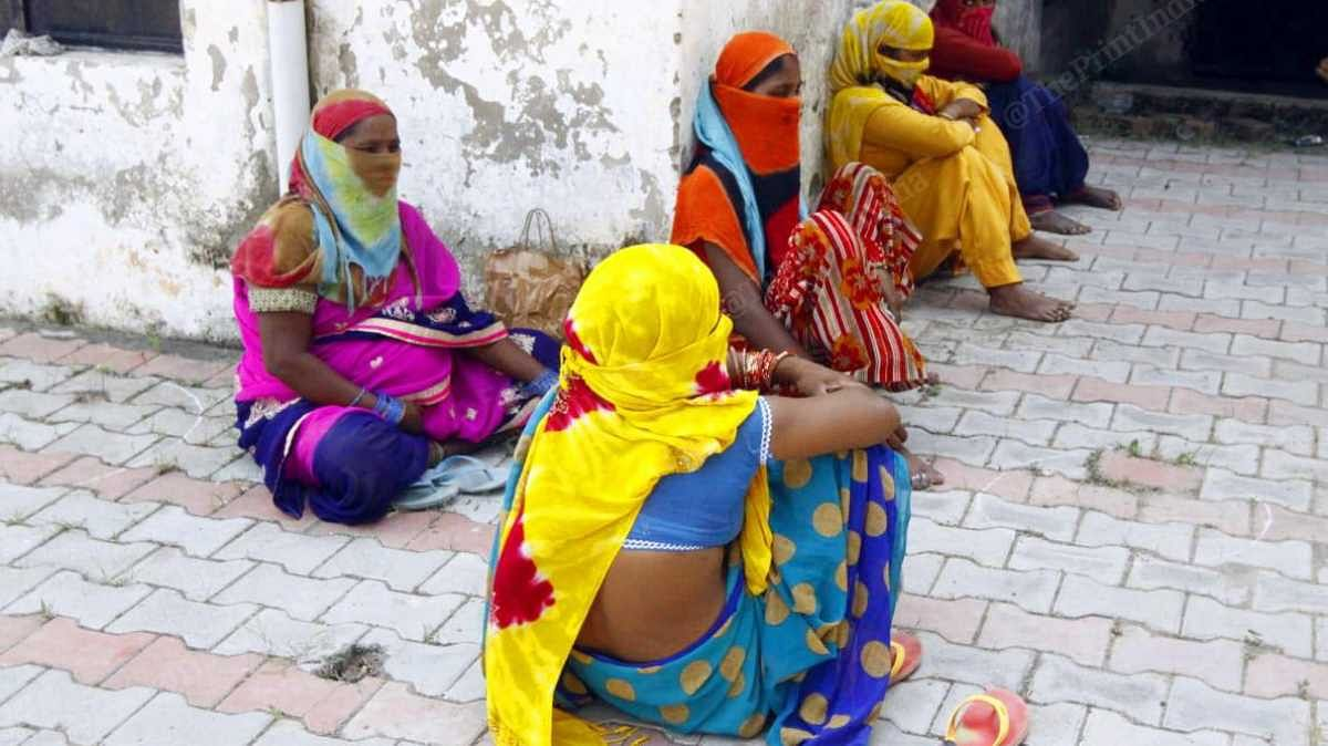 Woman wait as health teams in Bakarpur, Mohali, carry out awareness drive on Covid | Praveen Jain | ThePrint