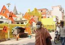 Residents walk past the Hanuman Garhi temple in Ayodhya on 30 September 2020, the day a special CBI court ruled that the 1992 Babri mosque demolition wasn't planned in advance and acquitted all accused   PTI