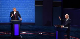 Democratic presidential nominee Joe Biden (R) and US President Donald Trump speak during the first US presidential debate in Cleveland, Ohio, on 29 September