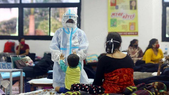 A healthcare worker at a CWG covid care centre in New Delhi | Suraj Singh Bisht | ThePrint